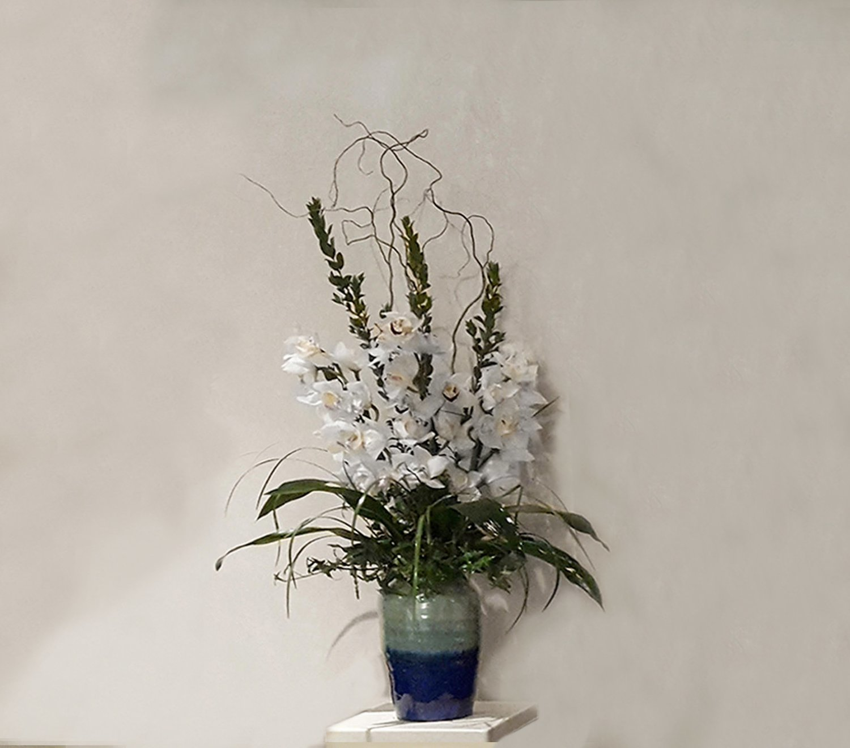 Funeral flower arrangements to honor loved ones lofendo flowers cymbidium orchid in ceramic vase izmirmasajfo